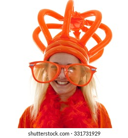 Young woman as Dutch orange supporter with crown over white background