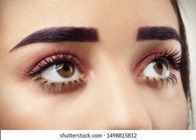 Young woman with dyed eyebrows and creative makeup, closeup