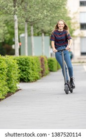 Young woman with e scooter