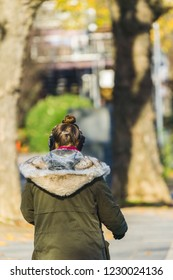 Young woman with ear warmer goes for a walk in autumn in germany cologne 2018.