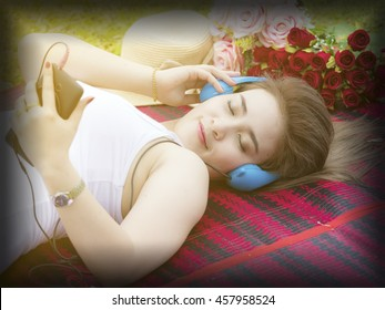 Young woman with earphones on blurred background