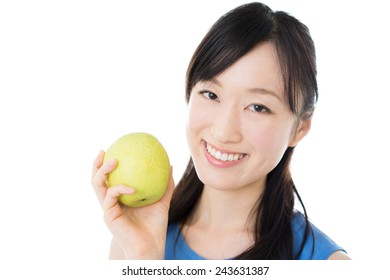 young woman eating apple isolated on white background