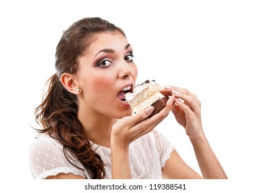 Young woman eating cake, isolated over white background