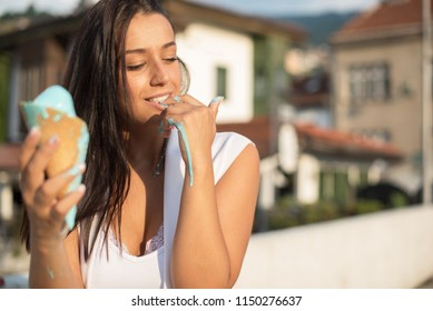 young woman eating and enjoying in ice cream