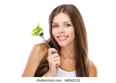 Young woman eating green salad, isolated on white background
