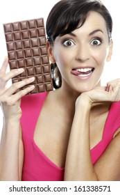 Young woman eating a huge chocolate bar