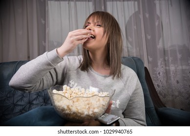 young woman eating popcorn