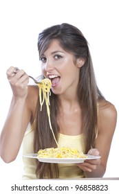 young woman eating spaghetti carbonara isolated on white
