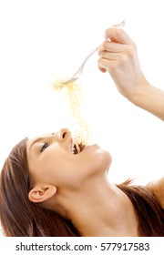 Young woman eating spaghetti, isolated on white background