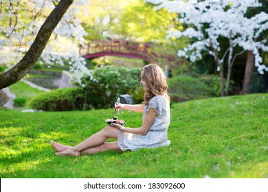 Young woman eating sushi in Japanese park