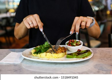 A young woman eats a tasty fresh Indian meals