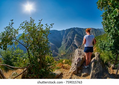 Young Woman at the edge of Mountain Gorge near Tatev Monastery in Armenia