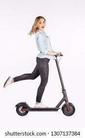 young woman with electric scooter