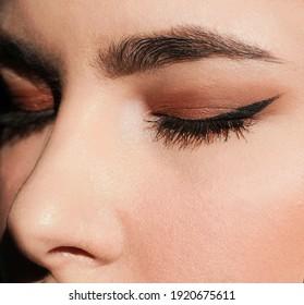Young woman with elegant makeup and long eyelashes. Eyelash extensions.