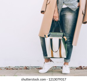 Young Woman in elegant outfit with oversize denim jacket and shopper bag