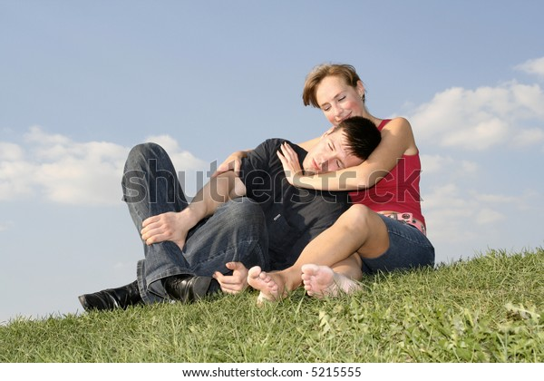 young woman embracing here boyfriend