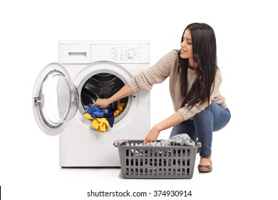 Young woman emptying a washing machine isolated on white background