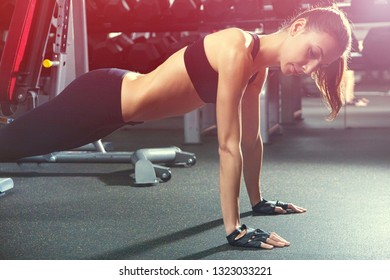 young woman is engaged in bodybuilding at the gym