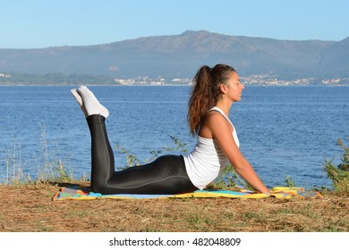 young woman is engaged in fitness outdoors