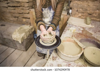 The young woman is engaging in pottery at the old build