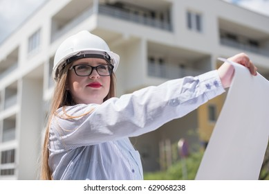 young woman engineer with architectural drawings