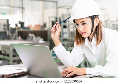 Young woman engineer working on robotics project,