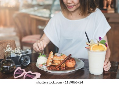 Young woman enjoy eating dessert in cafe on vacation trip