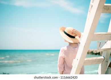 Young woman enjoying Adriatic sea side view from Bay watch stairs, Durres, Albania