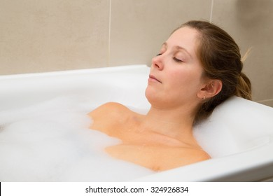 young woman enjoying a bath