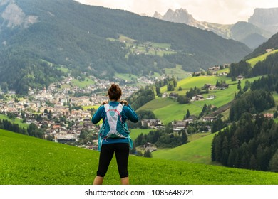 Young woman enjoying beautiful hike in Italian Dolomites. Hikking a trail in famous Dolomites, Italy.