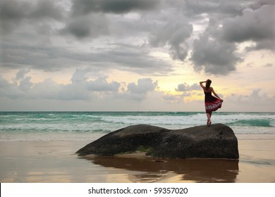 Young woman enjoying beautiful sunset