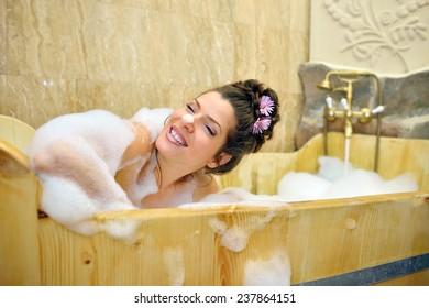 young woman enjoying bubble bath