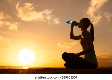 Young woman enjoying a drink of water.
