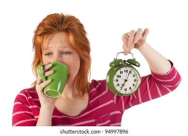 Young woman is enjoying het morning coffee while wake up very early