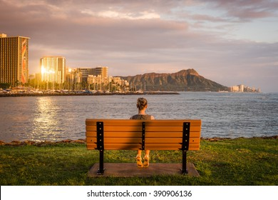 Young woman enjoying Honolulu views from Ala Moana Beach Park