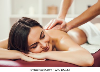 Young woman is enjoying massage on spa treatment.