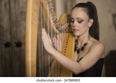 A young woman enjoying music while running on the instrument harp
