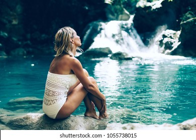 Young woman enjoying natural bathing by the Kawasan waterfall in Philippines