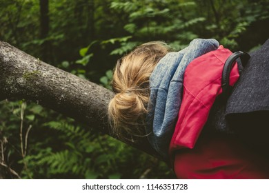 young woman enjoying nature trails in forest. vintage look