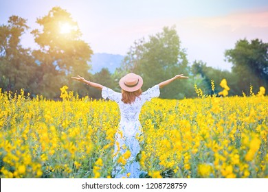 Young woman enjoying nature.portrait of happy beautiful happy youngwoman relaxing in park