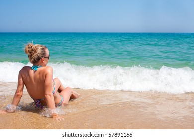 Young woman enjoying the ocean waves