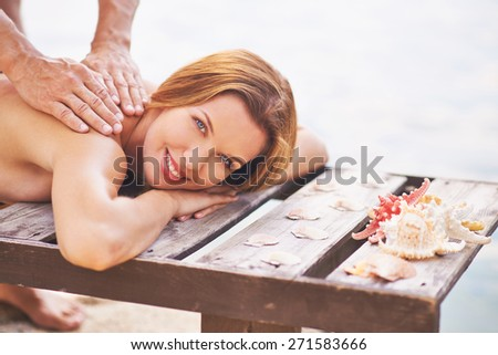 Young woman enjoying outdoor massage