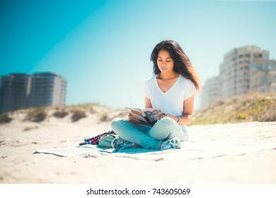Young woman enjoying sandy beach