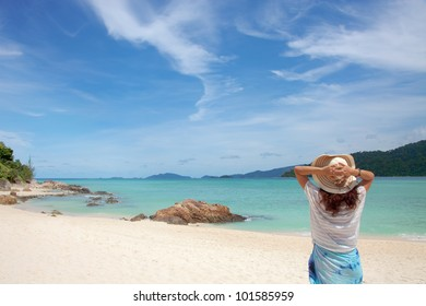 Young woman enjoying the sea view close to the sea