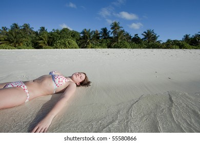 A young woman enjoying the silence of a dreamily beach