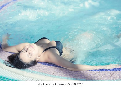 Young woman enjoying in a spa center. Young woman.