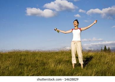 Young woman enjoying summer field