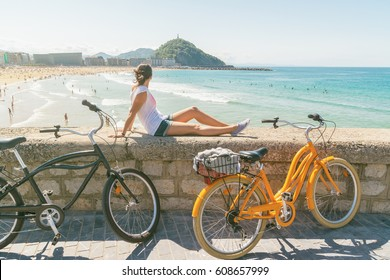 Young woman enjoying the view in San Sebastian at summer, Spain