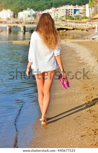 A young woman enjoying a walk on the beach