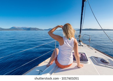 Young woman enjoying a yacht trip in the Mediterranean Sea